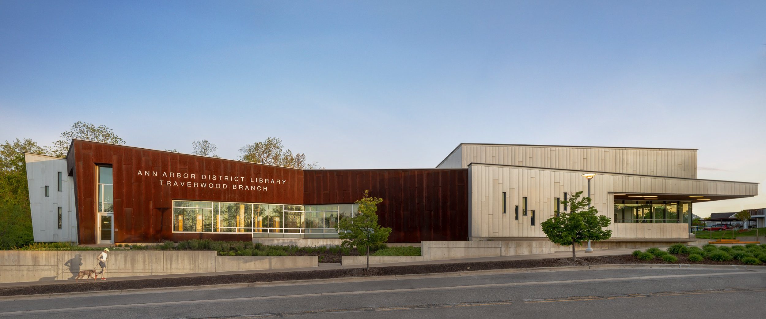 Elevation of metal steel and concrete facade of Traverwood Branch of Ann Arbor District Library System Project in Michigan Architecture Interior Design and Sustainable Design