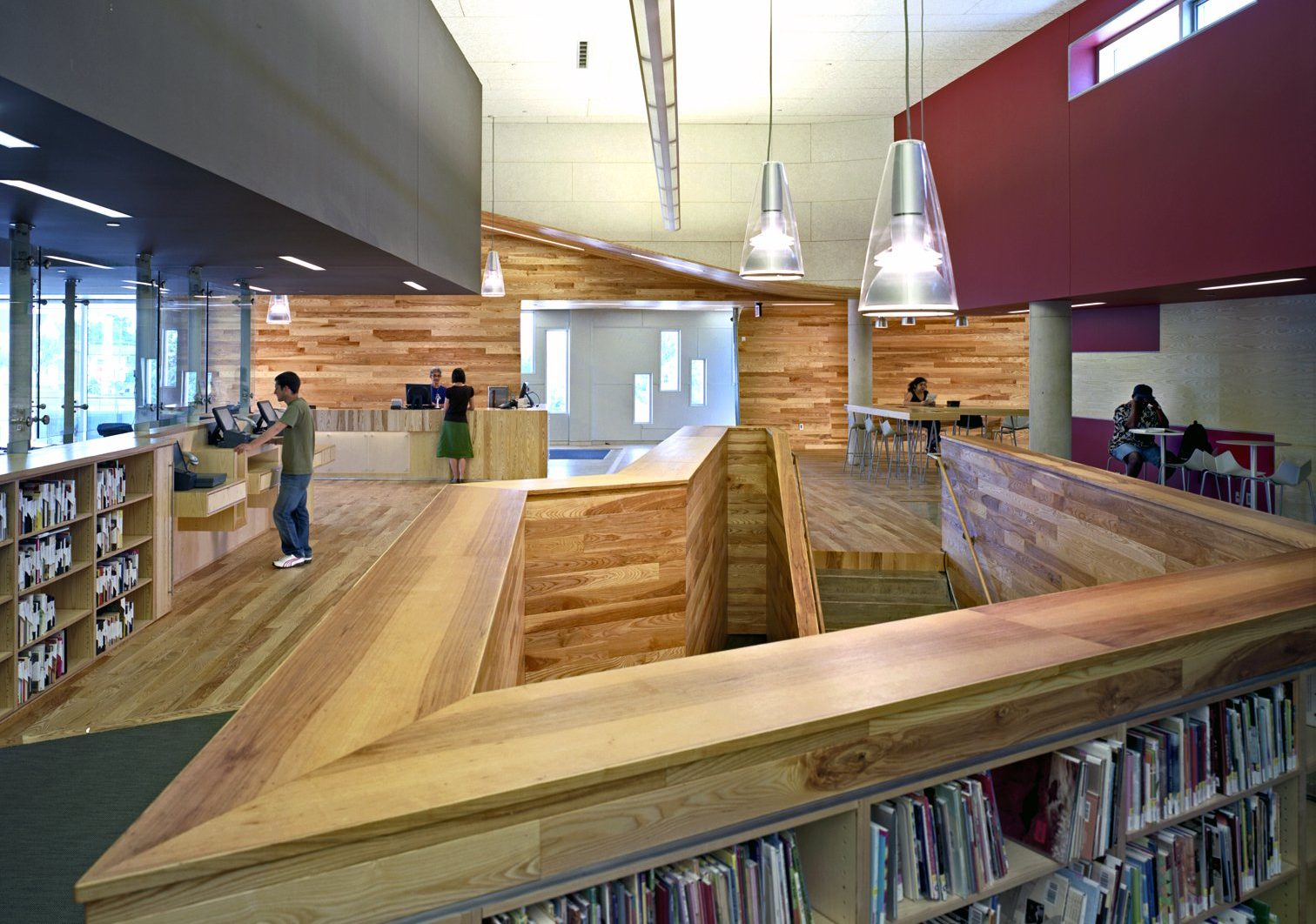 Interior view of ash wood stair at Traverwood Branch of Ann Arbor District Library System Project in Michigan Architecture Interior Design and Sustainable Design