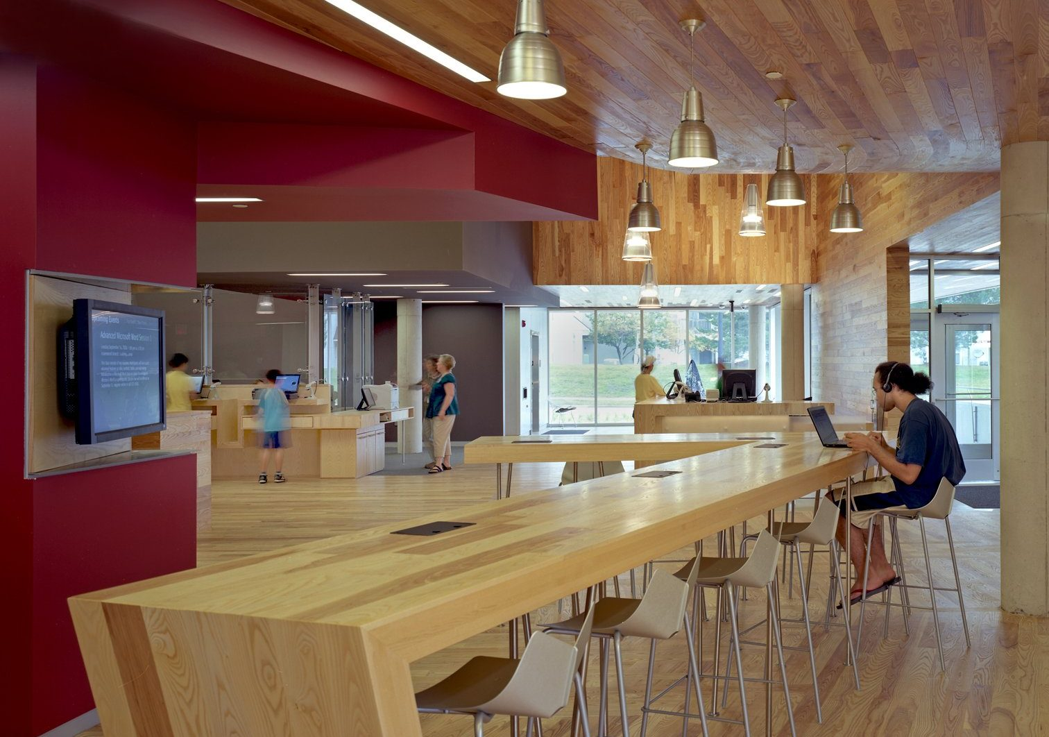 Interior view of ash wood study bar at Traverwood Branch of Ann Arbor District Library System Project in Michigan Architecture Interior Design and Sustainable Design