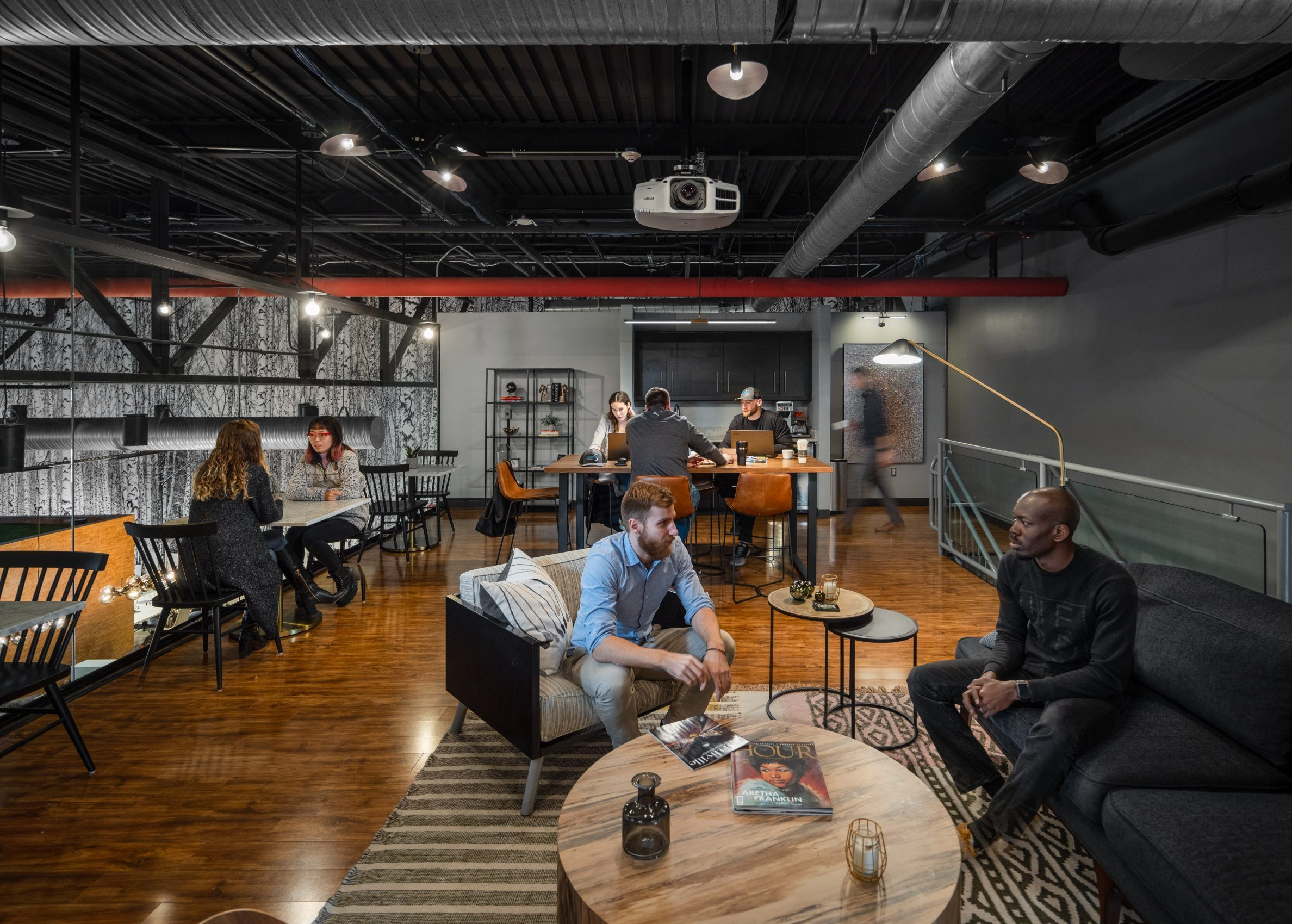 People sitting in mezzanine lounge at AMITY Co-Working project in Northville Michigan Architecture and Interior Design