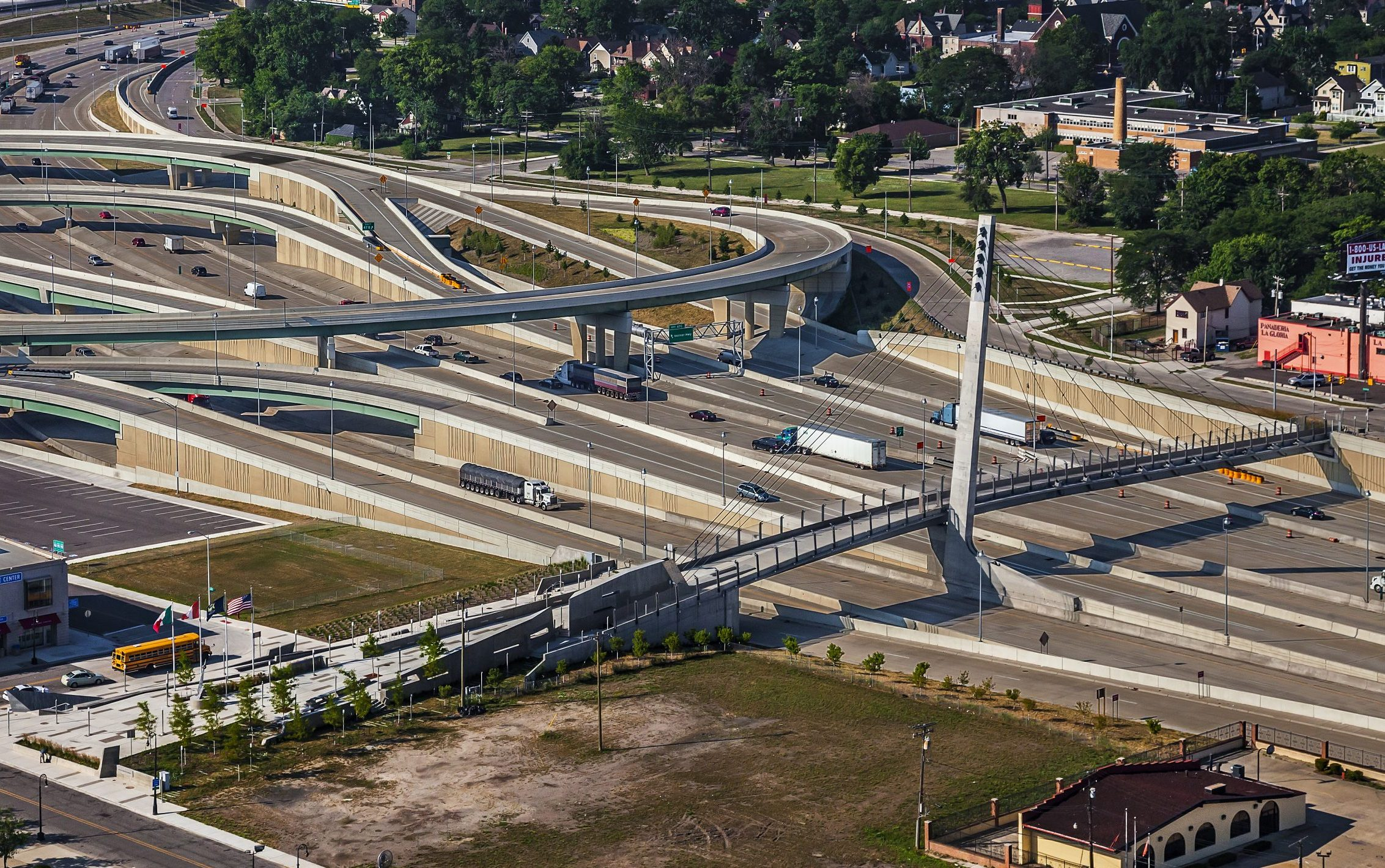 Drone aerial of freeway interchange and Bagley Avenue Pedestrian Cable Bridge Project in Detroit Michigan Urban Design and Infrastructure