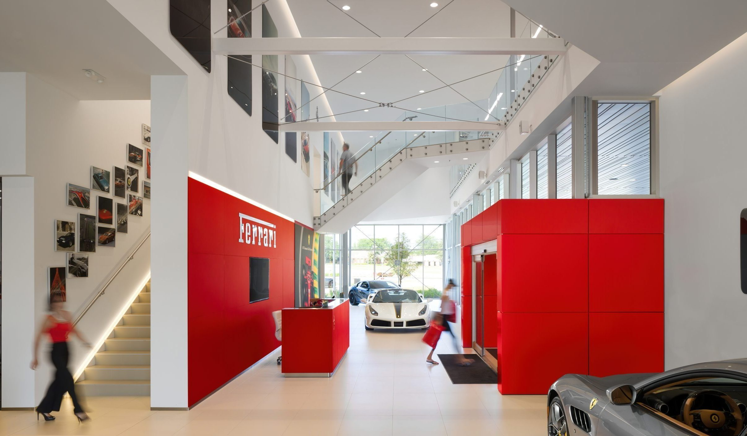 Interior view of lobby and stair at Cauley Ferrari of Detroit Dealership and Showroom Project in Michigan Architecture Interiors Computational Design