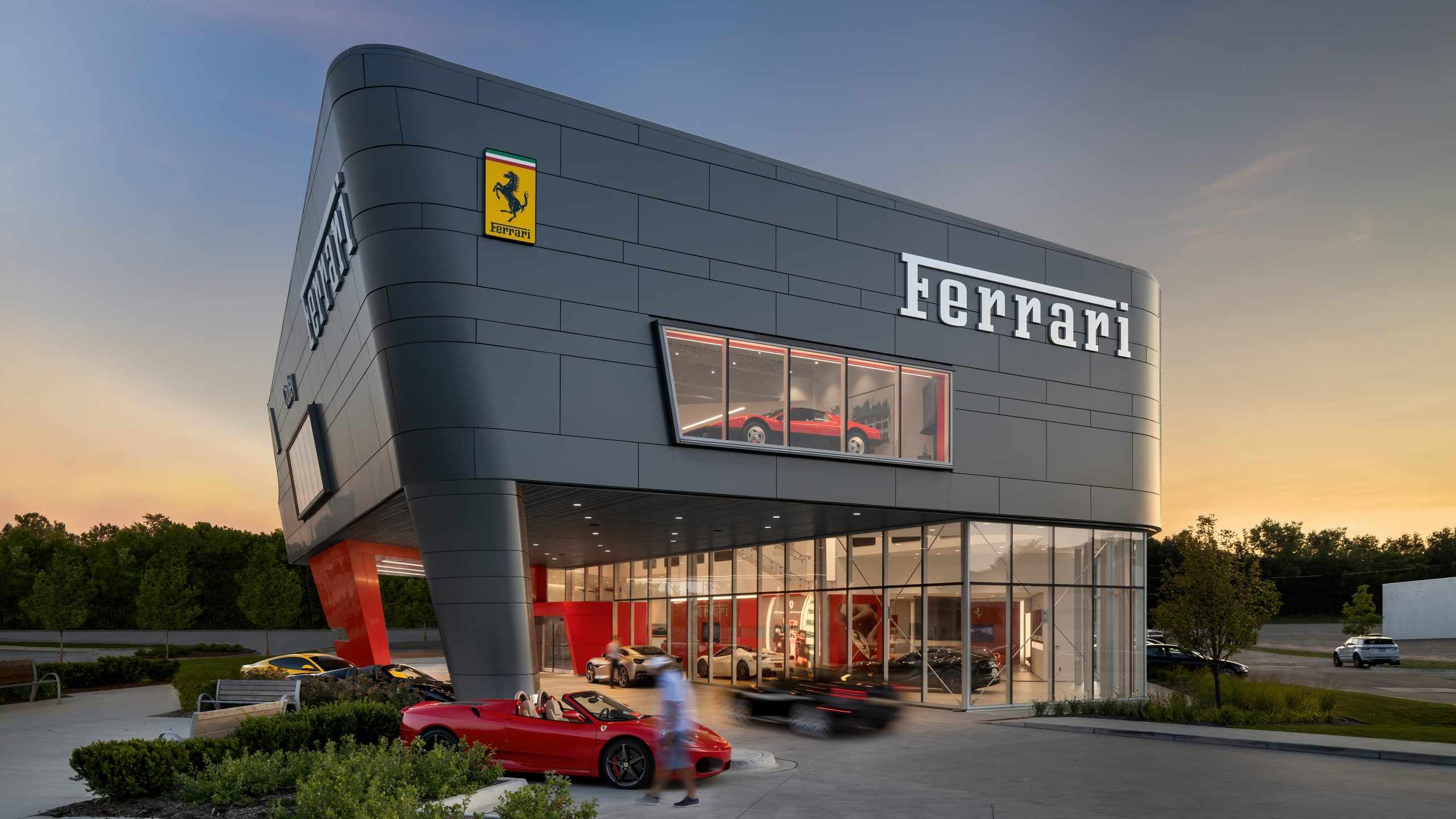 Detail of metal panel facade and showroom at Cauley Ferrari of Detroit Dealership and Showroom Project in Michigan Architecture Interiors Computational Design
