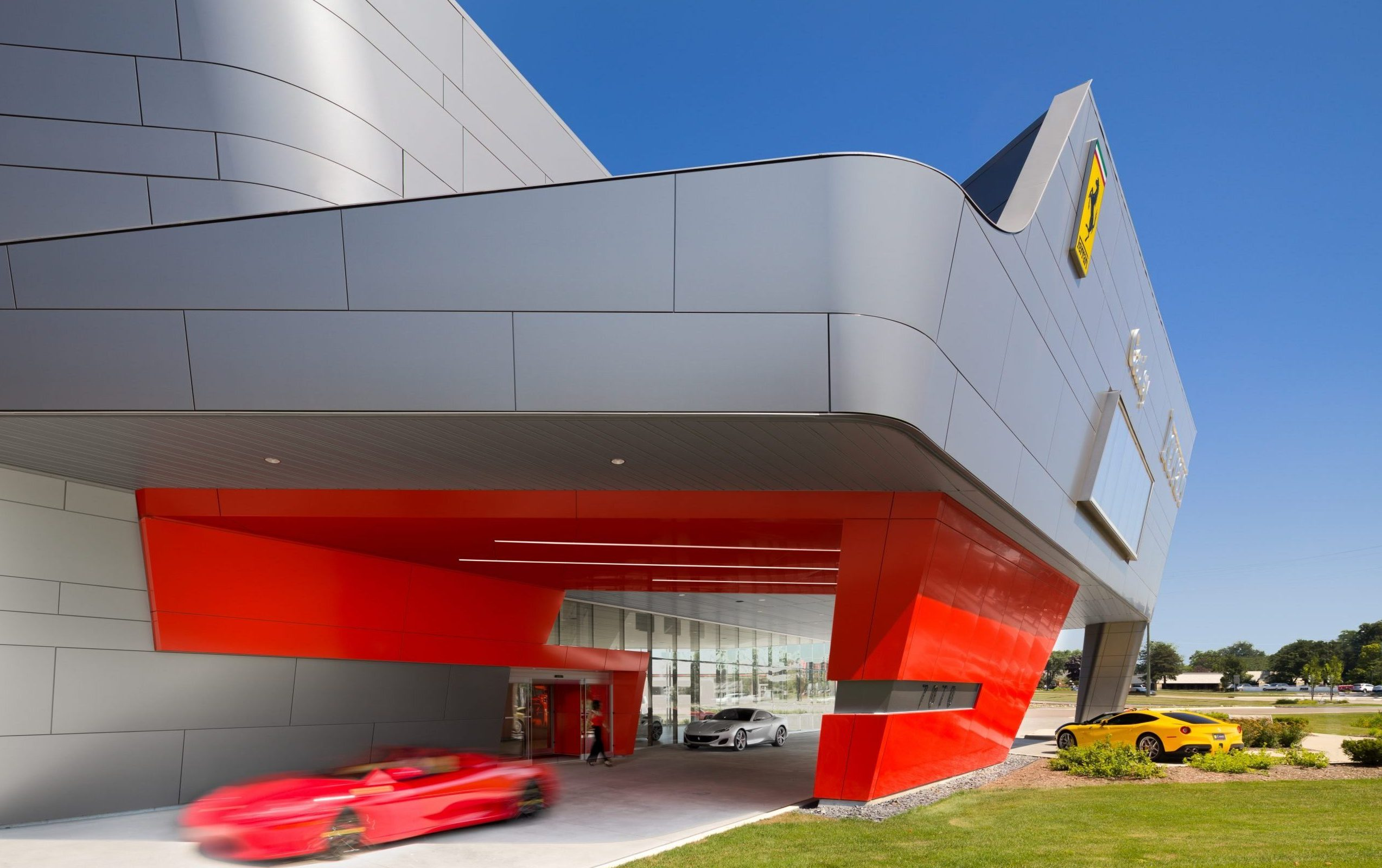 Detail of metal panel facade and underpass at Cauley Ferrari of Detroit Dealership and Showroom Project in Michigan Architecture Interiors Computational Design