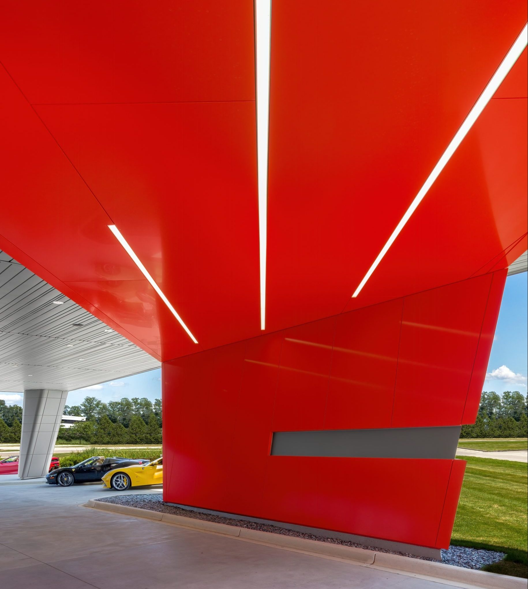Detail of red underpass and lighting at Cauley Ferrari of Detroit Dealership and Showroom Project in Michigan Architecture Interiors Computational Design