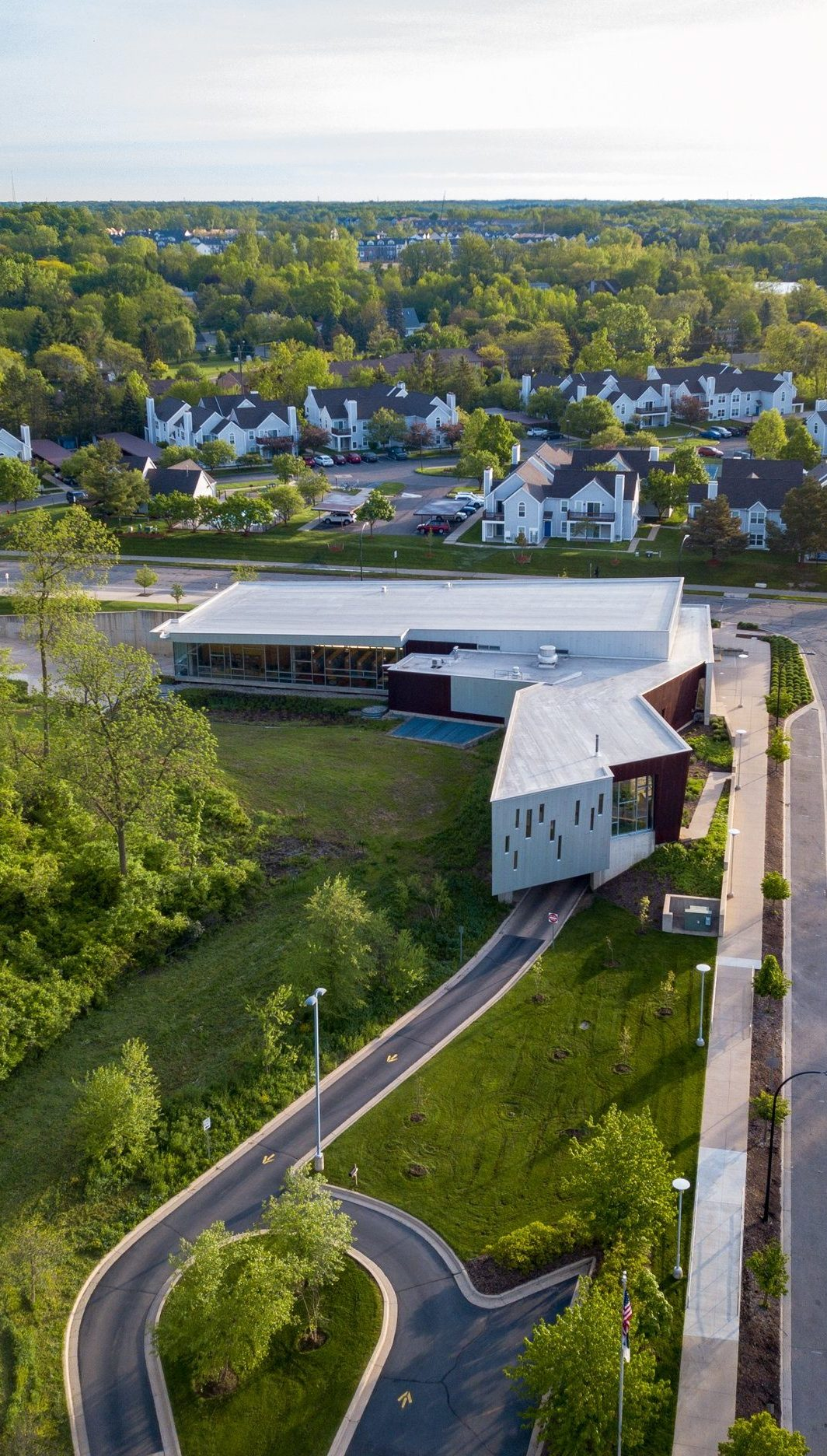 Drone aerial view of surrounding neighborhood at Traverwood Branch of Ann Arbor District Library System Project in Michigan Architecture Interior Design and Sustainable Design