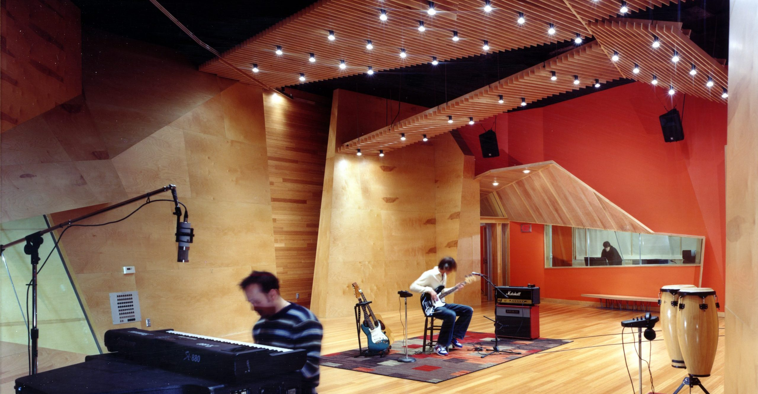 Band recording music in live room of Effigy Studio Project in Ferndale Michigan Architecture Interior Design