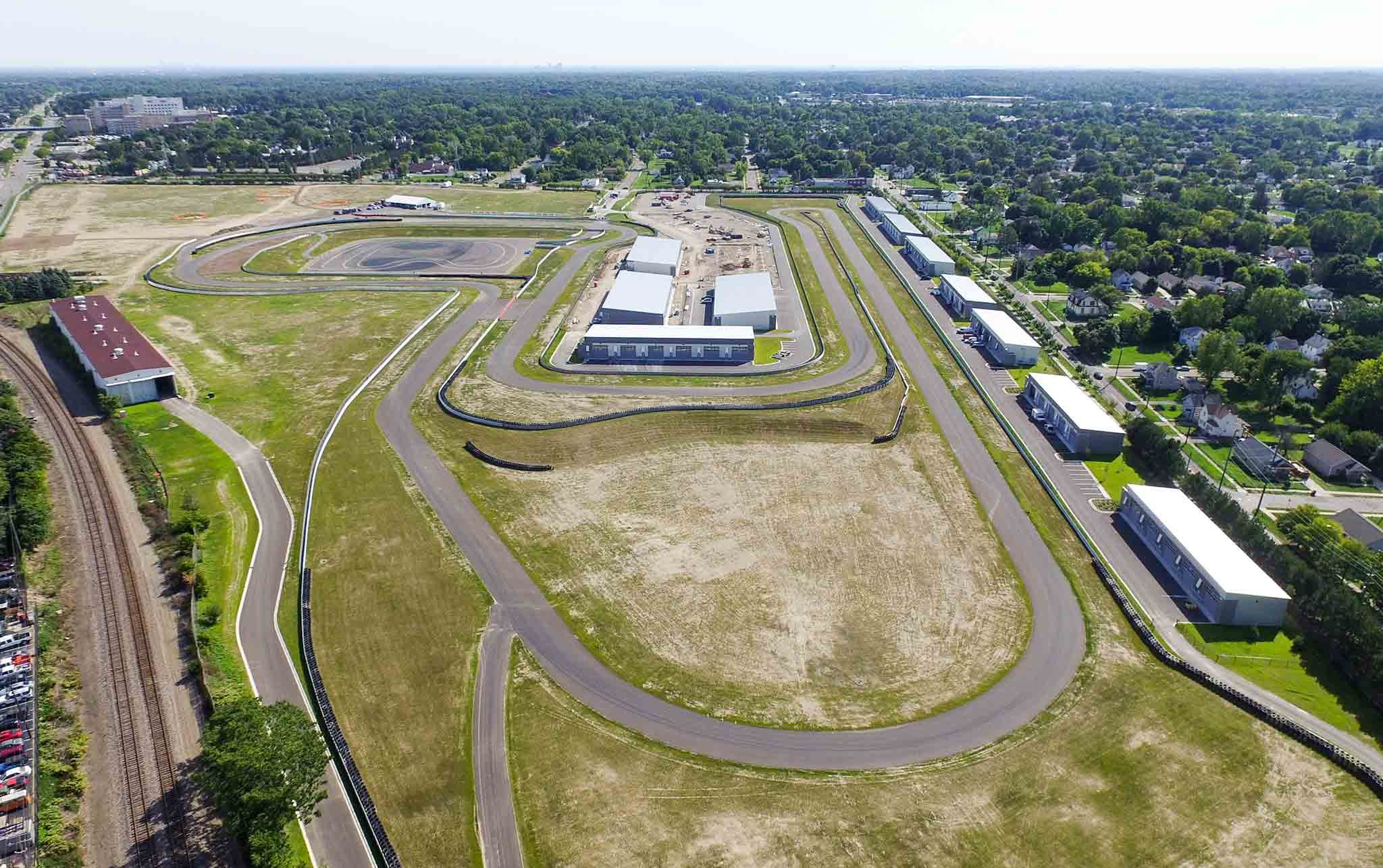 Aerial of track and site at M1 Concourse Car Condos Project in Pontiac Michigan Architecture Interior Design