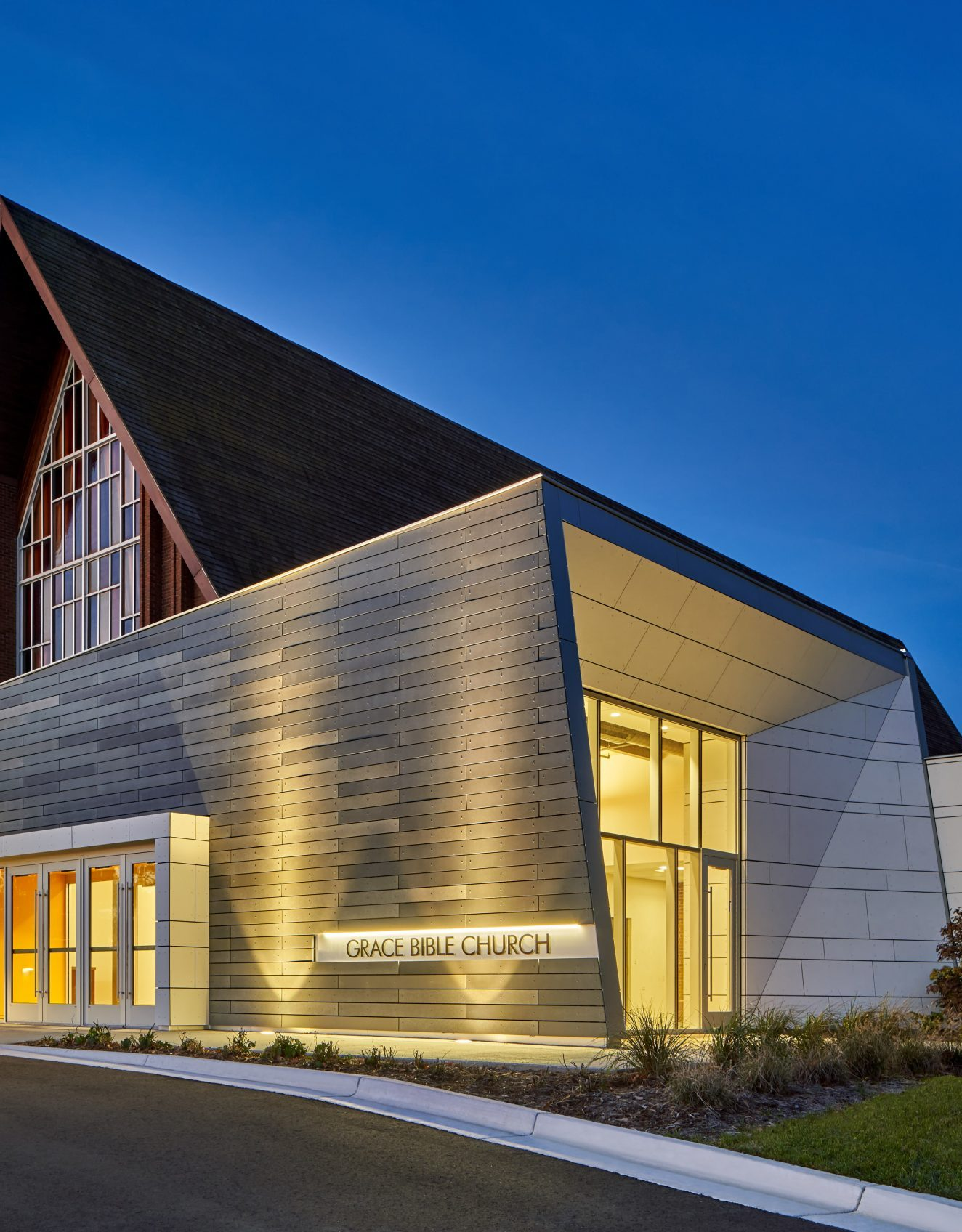 Night view of exterior panels at Grace Bible Church Project in Ann Arbor Michigan Architecture and Interior Design