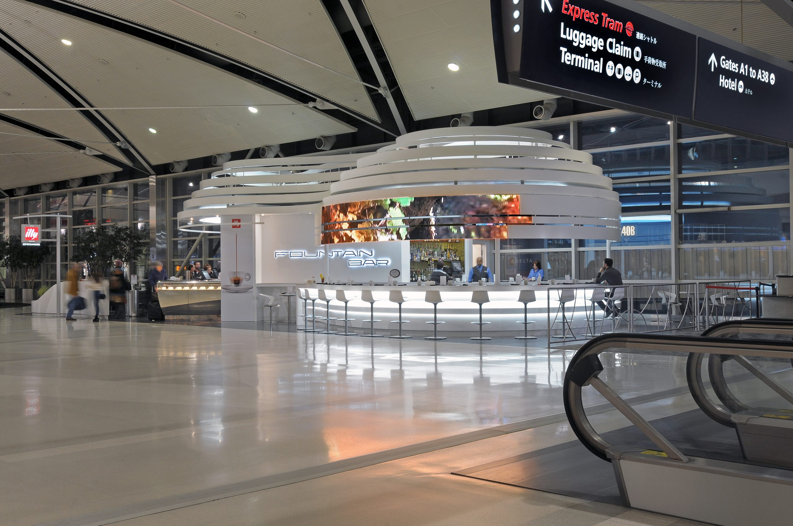 View of the form and bar at illy Caffe and Coffee Bar Project in Detroit Metro Airport McNamara Terminal collaboration with Studio H2G Interior Architecture