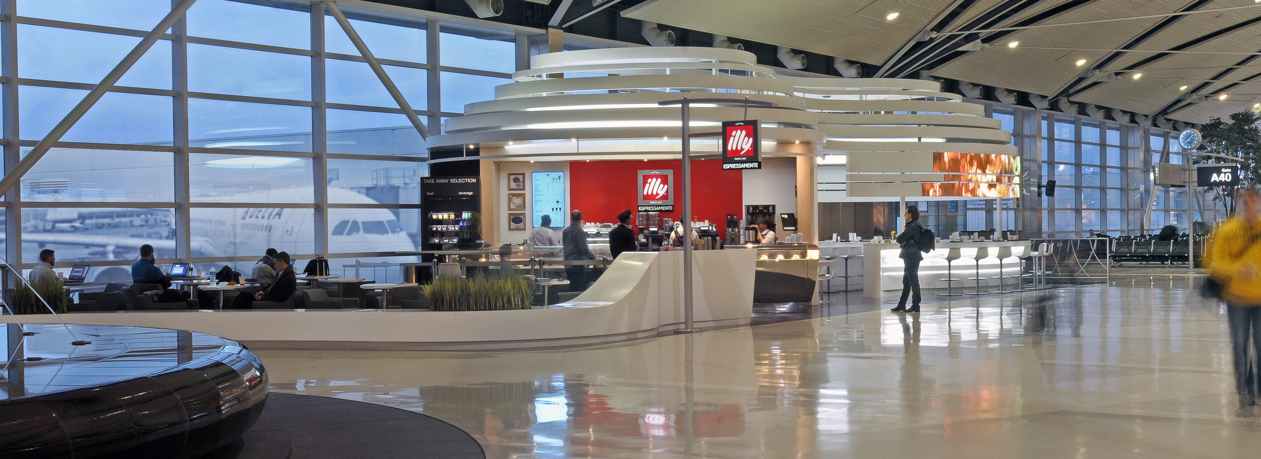 People sitting and ordering at illy Caffe and Coffee Bar Project in Detroit Metro Airport McNamara Terminal collaboration with Studio H2G Interior Architecture