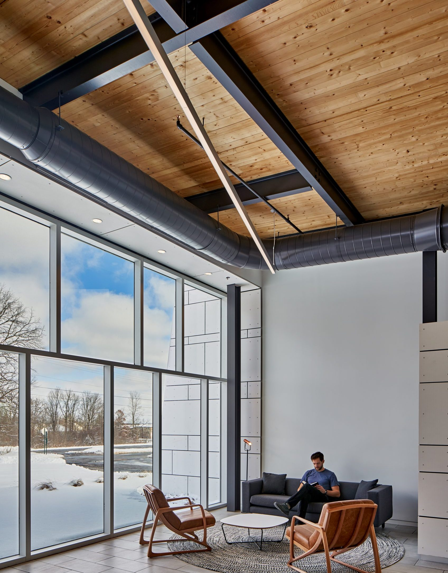 Interior view of sitting lounge and cross laminated timber ceiling at Grace Bible Church Project in Ann Arbor Michigan Architecture and Interior Design